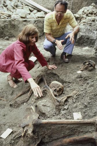 Gilbert Grosvenor and Sara Bisel observe ancient bones at Herculaneum.