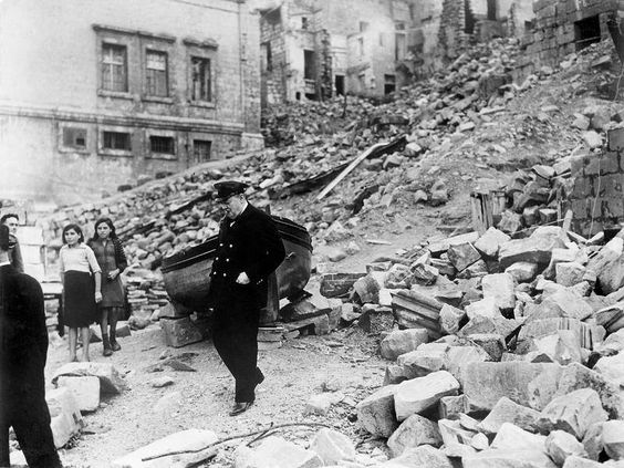 Churchill inspects air raid damage 1943