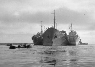 the damaged OHIO tanker supported by Royal navy destroyers